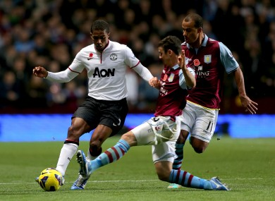 Enda Stevens tackles Manchester United's Antonio Valencia while playing for Aston Villa in 2012.
