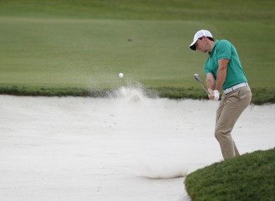 Rory McIlroy hits from the sand on the 12th hole during the third round of the Cadillac Championship golf tournament.