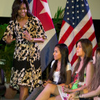 President Barack Obama and first lady Michelle Obama greet children and families of U.S. embassy personnel during an event at the Melia Habana Hotel in Havana.<span class=
