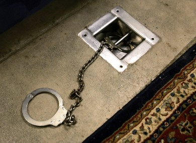 A foot shackle is bolted to a floor covered by a decorative carpet, inside Interview Room 1, where prisoners are interrogated, inside Cell Block A at Camp 5 maximum security prison, Guantanamo Bay US Naval Base, Cuba