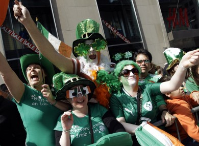 Deirdre Kelly, Linda Forth, Darren McCarthy and Eimear Ni Bhriain, of Dublin cheer on the marchers during the 2012 parade in New York.