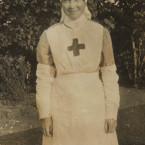 The teenager in her volunteer nurse uniform. <span class=