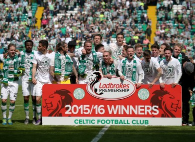 The Celtic players are crowned champions.