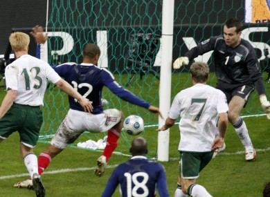 France's Thierry Henry, left, passes the ball as Ireland's goalkeeper Shay Given, right, tries to stop it, just before William Gallas (unseen) scored the goal for France during their World Cup qualifying playoff second legmatch at the Stade de France stadium in Saint Denis outside Paris in November 2009.