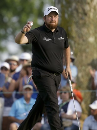 Shane Lowry reacts after a birdie on the ninth.