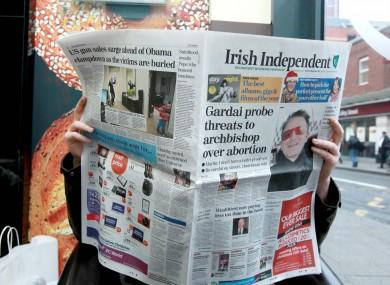File photo: Man reading The Irish Independent newspaper