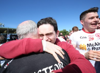 Mickey Harte celebrates Tyrone' s 14th Ulster title with his son at Clones.