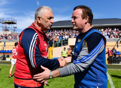 Longford manager Denis Connerton with his Cork counterpart Peadar Healy after Saturday's game.