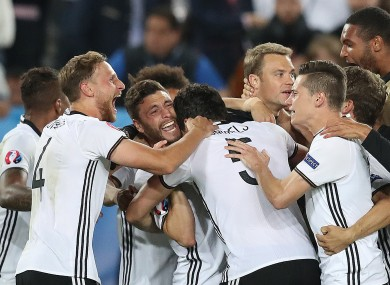 Germany players celebrate after winning the Euro 2016 quarter-final.