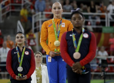 Netherlands' Sanne Wevers, centre, gold, United States' Lauren Hernandez, left, silver, and United States' Simone Biles, right, stand after receiving their medals for balance beam during the artistic gymnastics women's apparatus final.