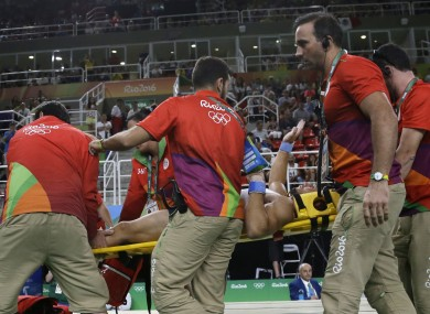 France's Samir Ait Said is carried away on a stretcher after he injured himself while performing on the vault during the artistic gymnastics men's qualification at the 2016 Summer Olympics in Rio de Janeiro.
