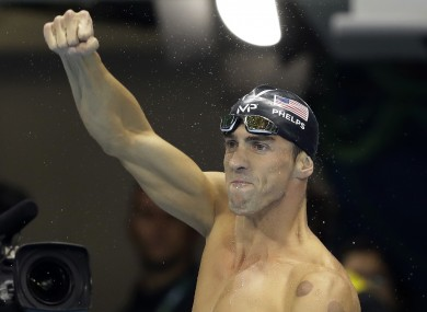 United States' Michael Phelps celebrates after winning the gold medal in the 200m butterfly.
