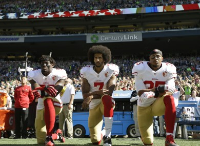 Colin Kaepernick takes a knee before the 49ers' game with the Seahawks.