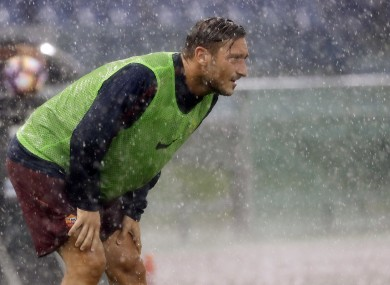 Francesco Totti looks on in the rain before being introduced as a substitute against Sampdoria.