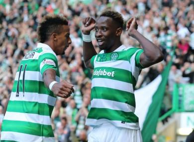 Moussa Dembele celebrates with Scott Sinclair.