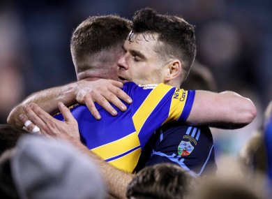 Dublin team-mates Ciaran Kilkenny and Kevin MacManamon hug after the final whistle.