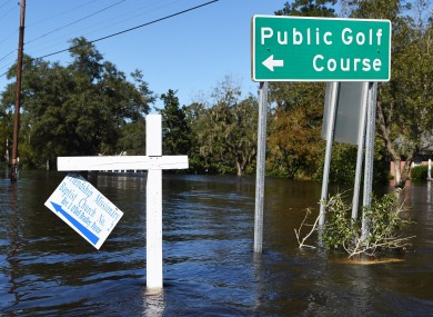 Floodwater surround road signs ub Nichols, North Carolina, as people were rescued from Hurricane-related flooding.