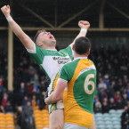 Glenswilly's Oisin Crawford and Ciaran Bonner rejoice at the final whistle.<span class=