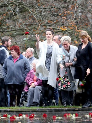 Families gathered outside Farmleigh House at Missing Persons Day 2015.