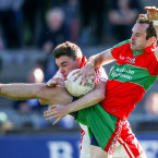 Ballymun's Carl Connolly clashing for the ball with St Brigid's Paddy Andrews.<span class=