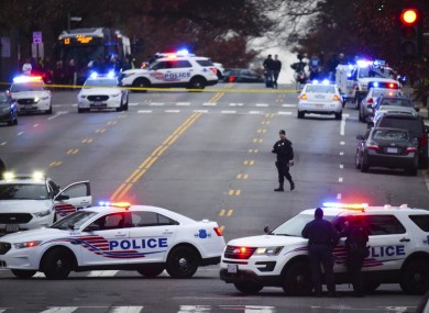 Police secure the scene near Comet Ping Pong in Washington DC.