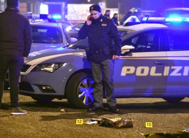 Italian police collecting evidence at the scene where Berlin terror suspect Anis Amri was shot dead by police.