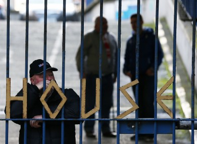 People standing behind the gates of Apollo House last month.