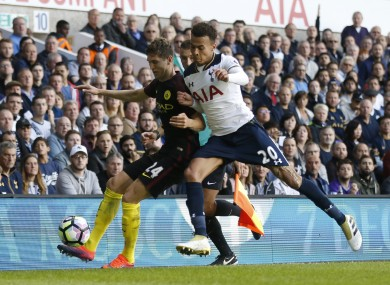 Tottenham Hotspur''s Dele Alli, right, challenges Manchester City''s John Stones for the ball in the reverse fixture earlier this season.
