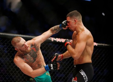 Conor McGregor fights Nate Diaz during their welterweight MMA bout at UFC 202 last August