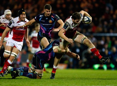 Iain Henderson attempts to escape a tackle.