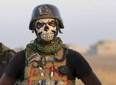 member of Iraq's elite counterterrorism forces stands as they advance towards the city of Mosul, Iraq, last October.