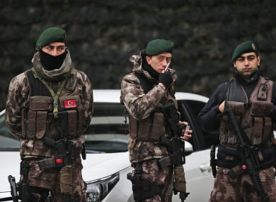 Turkish police officers stand guard at Istanbul's headquarters prior to a news conference regarding the arrest.