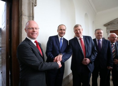 Stephen Donnelly (left) with Fianna Fáil party leader Micheál Martin and Pat Casey at Leinster House yesterday.