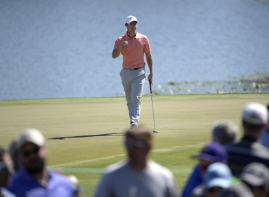 Rory McIlroy, of Northern Ireland, acknowledges the crowd after making a birdie putt on the sixth green during the third round of the Arnold Palmer Invitational golf tournament.