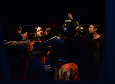 Members of the Italian performance troupe Quadri Plastici recreate Caravaggio's painting The Taking of Christ as a 'living painting' in front of the National Gallery in Trafalgar Square, London.