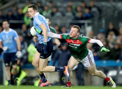 Dublin's Dean Rock escapes from Mayo's Colm Boyle.