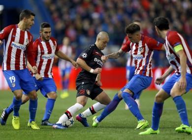 Leverkusen's Javier Hernandez is swarmed by four Atleti players.