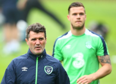 Ireland assistant manager Roy Keane at today's training session at Fota Island, with defender Kevin Long looking on.