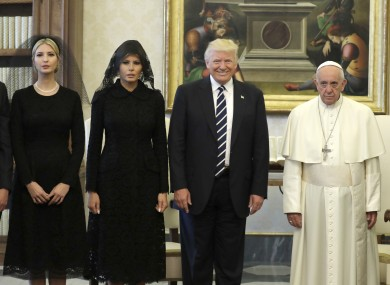 Donald Trump and Pope Francis pose for the press corps at the Vatican along with Trump's daughter Ivanka and wife Melania.