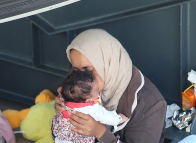 A mother and her child among the rescued.