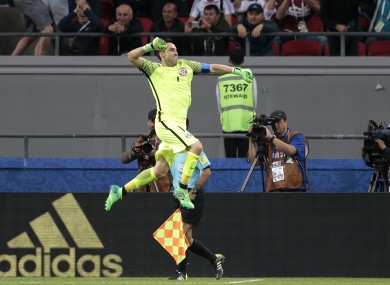 Claudio Bravo celebrates winning the Confederations Cup semi-final.