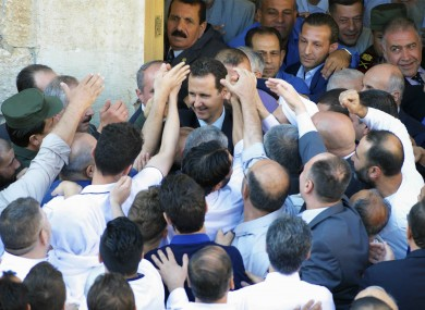 Assad (centre) meets with supporters.