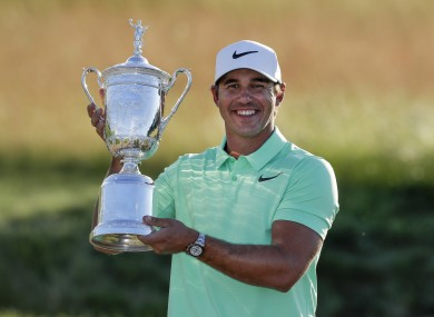 Brooks Koepka poses with the trophy after the US Open golf tournament.