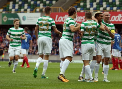 The Celtic players celebrate Sinclair's goal.