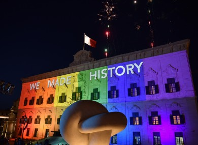 The Maltese Prime Minister's office is lit up in rainbow colours with fireworks exploding after parliament voted in favour of same-sex marriage in Valletta, capital of Malta last night.