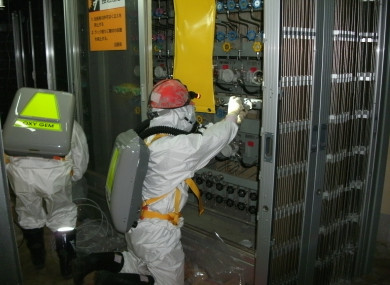 Workers inside the crippled nuclear plant