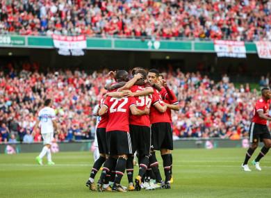 The Man United players celebrate Henrikh Mkhitaryan's goal.