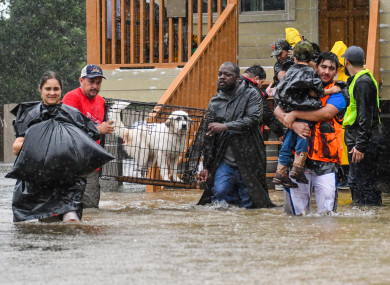 Volunteers and First Responders help flood victims evacuate to shelters in Houston, Texas.
