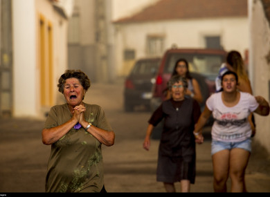 Residents flee in panic from the village Aldeia do Mato.