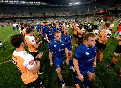 Cheetahs players clap off the Leinster team after the game.